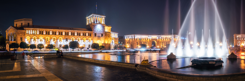 Panoramic view of The Government of the Republic of Armenia on Republic Square with dancing fountains at night in Yerevan, Armenia.